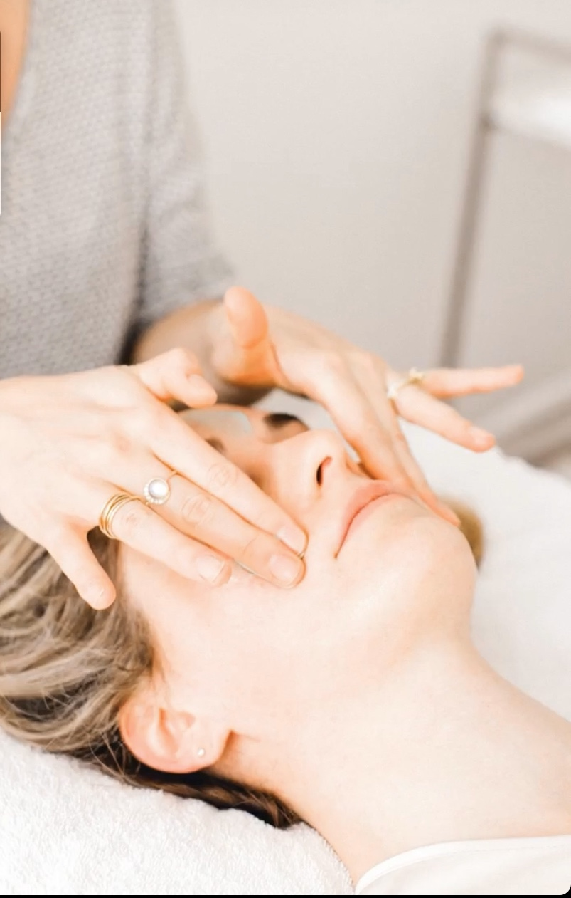 hands touching face during skin resurfacing service